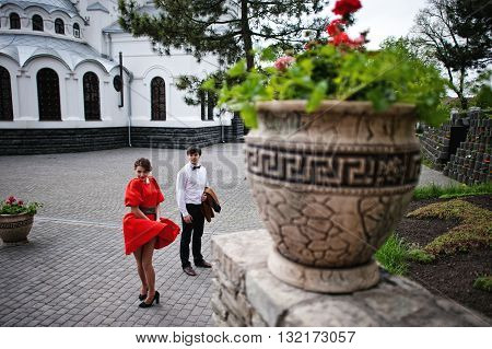 Couple Dancing In Love Background Church. Stylish Man At Velvet Jacket And Girl In Red Dress In Love