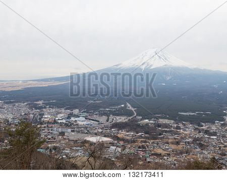 Tokyo - January 29 2015: View of the volcano Mount Fuji and visible snowy peak of the volcano in the winter January 29 2015 Tokyo Japan