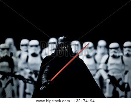 BLOOMFIELD NJ - MAY 30 2016: Hasbro Black Series Darth Vader with light saber fronting an Imperial army of stormtroopers