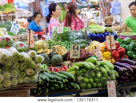 Hong Kong, Special Administrative Region of the People's Republic of China - 19 April 2016: women selling vegetables on traditional asian market