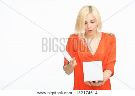 Present. woman in orange exciting to open present or gift