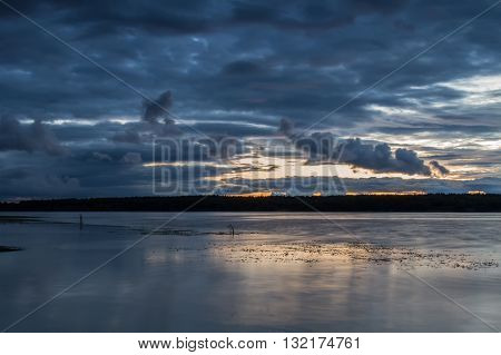 Sunset with beautiful clouds over the river Volga in Russia