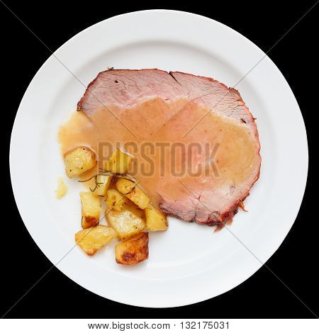 Roasted veal fillet with fried potatoes, isolated on black background