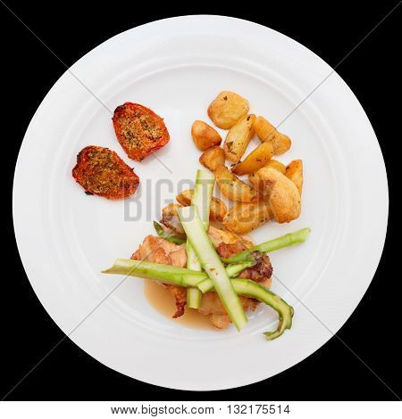White meat and vegetables isolated on black background
