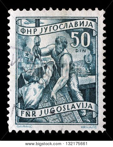 ZAGREB, CROATIA - SEPTEMBER 13: A stamp printed in Yugoslavia shows stevedores, domestic economy Series, circa 1952, on September 13, 2014, Zagreb, Croatia