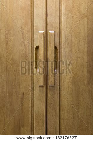 wood door handle with wood door background