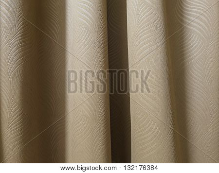 Closeup surface brown curtain in bedroom backgroung
