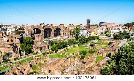 Panoramic view over the ruins of the Roman Forum with the Coliseum in the background in Rome Italy