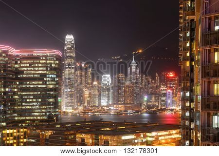 Hong Kong Skyline and Victoria Harbour at night from Tsim Sha Tsui on Kowloon.