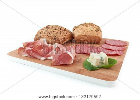 cereal bread, speck, salami and gorgonzola on white background