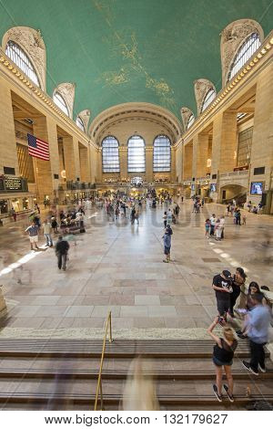 NEW YORK CITY, USA - May 28, 2016: Famous New York City landmark Grand Central Station full of tourists and commuters