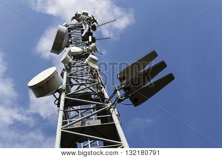Cell Phone Transmitters On Telecommunication Tower On Sunny Day