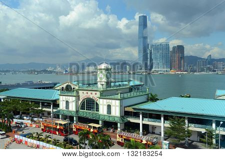 HONG KONG - NOV 9: Star Ferry Central Pier and Kowloon Skyline across Victoria Harbour on Nov 9, 2015 in Hong Kong. Star Ferry is a historic passenger ferry service across Victoria Harbour.