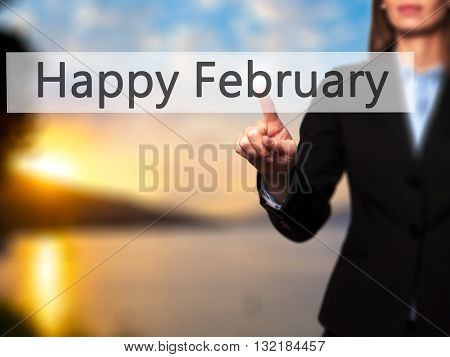 Happy February - Businesswoman Hand Pressing Button On Touch Screen Interface.