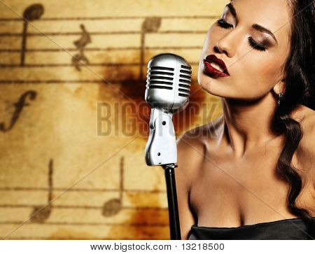 Beautiful singer against abstract background