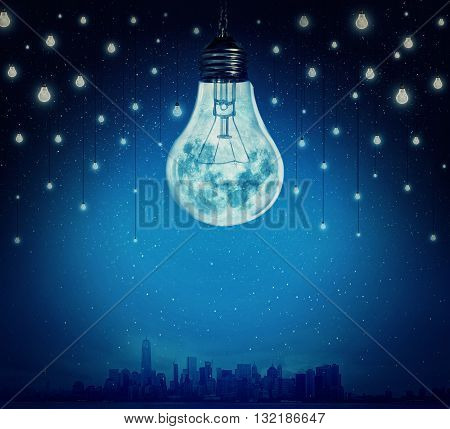 Moon and stars in shape of bulbs light over a city. Surreal background. Alternative energy concept