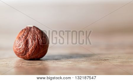 macro hazelnut isolated natural ingredient on wood