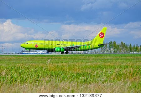 SAINT PETERSBURG RUSSIA - MAY 11 2016. VP-BND S7 Siberia Airlines Boeing 737 Next Gen airplane is riding on the runway after landing in Pulkovo airport