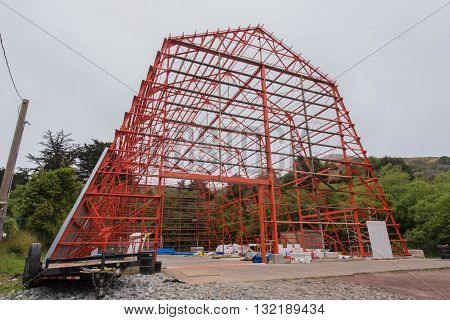 Barn structure of iron without walls during construction.