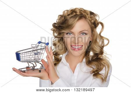 beautiful woman with trolley for shopping isolated on white