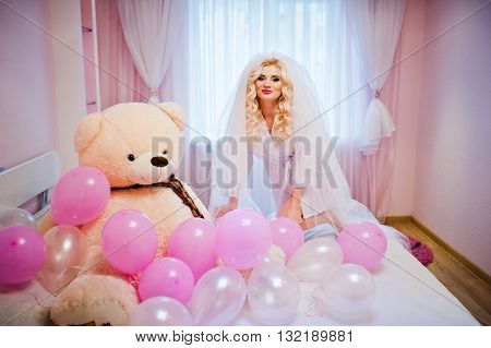 Young Sexy Blonde Bride Having Fun At Her Pink Room