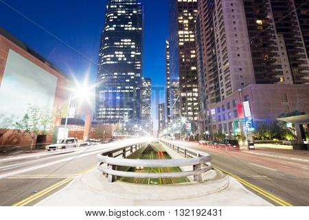 busy traffic on road in downtown of los angeles at night