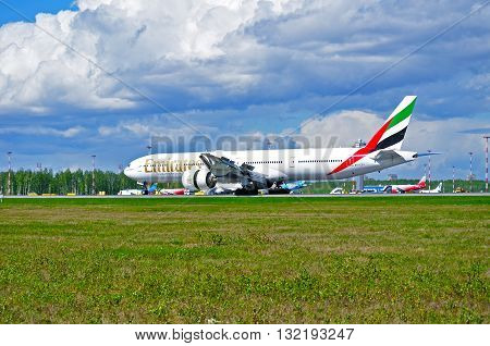 ST PETERSBURG RUSSIA - MAY 11 2016. A6-EBY Emirates Airline Boeing 777 airplane rides on the runway after landing in Pulkovo International airport