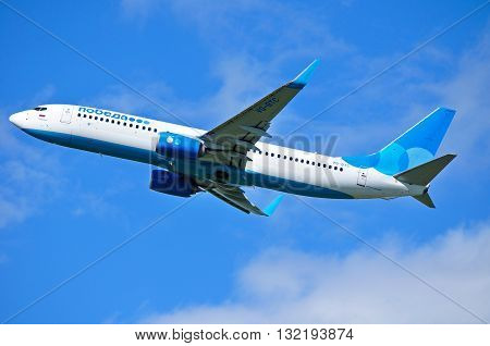 ST PETERSBURG RUSSIA - MAY 11 2016. VQ-BTC Pobeda Airlines Boeing 737 Next Gen airplane is flying in the sky after departure from Pulkovo International airport