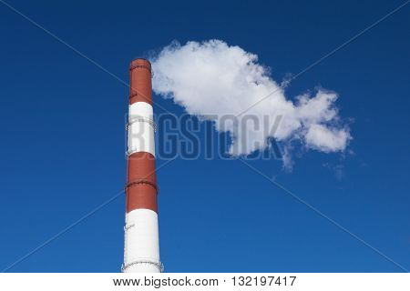 The red and white colored chimney and white smok