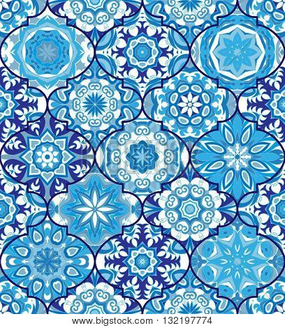 Vector ethnic colorful bohemian pattern in blue colors with big abstract flowers. Geometric background with Arabic, Indian, Moroccan, Aztec motifs. Ornate print with mandalas within clipping mask