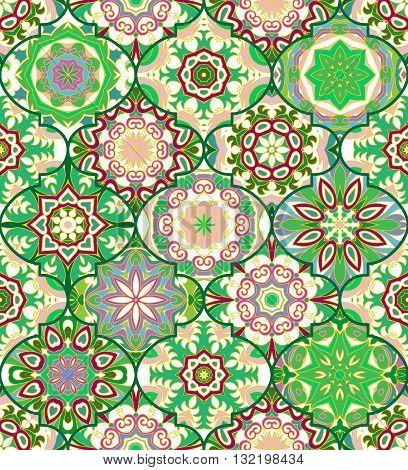 Vector ethnic colorful bohemian pattern in green colors with big abstract flowers. Geometric background with Arabic, Indian, Moroccan, Aztec motifs. Ornate print with mandalas within clipping mask