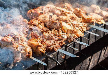 Appetizing hot shish kebab on metal skewers