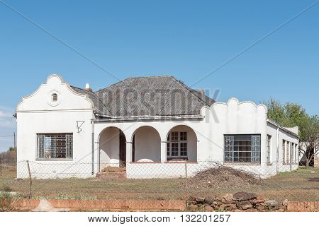 An empty house in Springfontein in the Southern Free State with several broken windows typical of the decline of rural areas