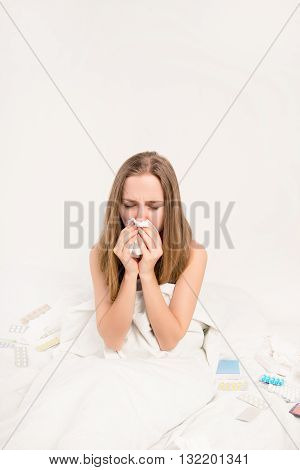 Close up portrait of ill woman with fever and running nose