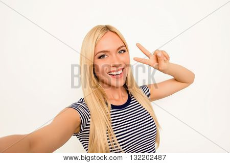 Blonde Happy Woman Making Selfie And Showing Two Fingers