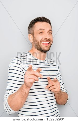 Cheerful Happy Smiling  Businessman Gesturing And Pointing On Camera