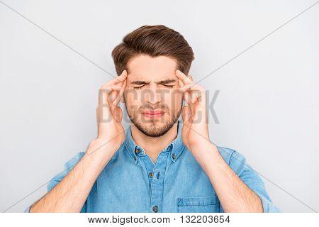 Portrait Of Sick Sad Businessman Having Strong Headache