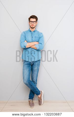 Full Length Portrait Of  Stylish Man In Glasses With Crossed Hands