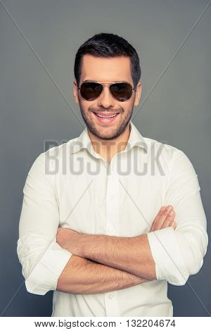 Cheerful Man In Spectacles With Crossed Hands