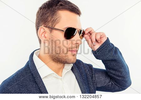 Side View Photo Of Serious Man Touching Spectacles