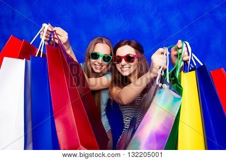 Young Pretty Women In Glasses With Shopping Packages In The Shop