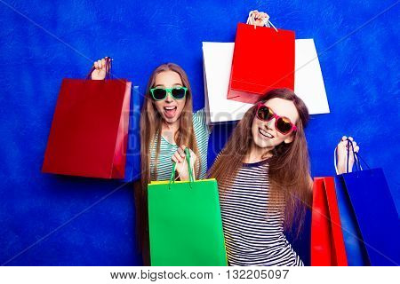 Attractive Happy Customers With Packets  Of Clothes After Shopping