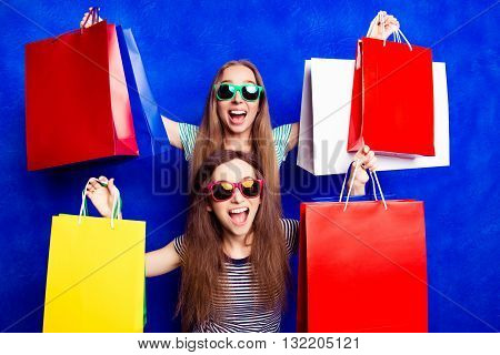 Sale! Happy Cheerful Sisters Showing Their Purchases