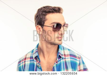 Handsome cute man with his glasses  on a white background