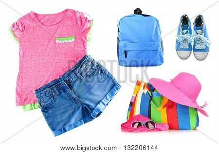 Set of little girl summer clothes isolated on white