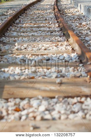 Railway track receding into the distance close-up.