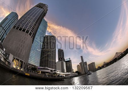 BRISBANE, AUSTRALIA - MAY 25 2016: Fisheye view sunset over Brisbane citycape and Story Bridge, view from the river ferry at Riparian Plaza on Eagle Street Pier