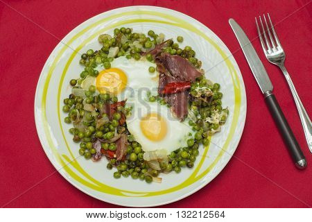 eggs with peas and ham, peas spicy with cayenne pepper