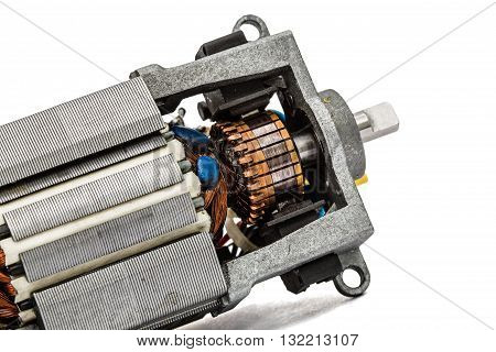 Part of small electric motor close-up isolated on white background