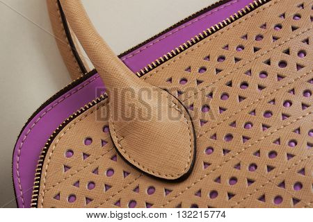 Detail of leather bag with perforation close-up